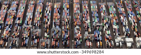 Aerial picture of containers in the harbour of Rotterdam with lot's of different colors - stock photo