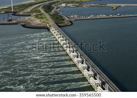 Aerial picture of the Oosterscheldekering, a storm surge barrier which is part of the delta works to protect Holland from high sea level - stock photo