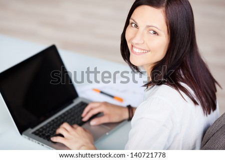 Aerial portrait of businesswoman typing on her laptop - stock photo