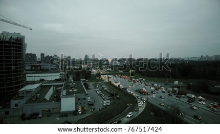 Aerial rising shot of big city highway intersection in the evening rush hour. Moscow, Russia
