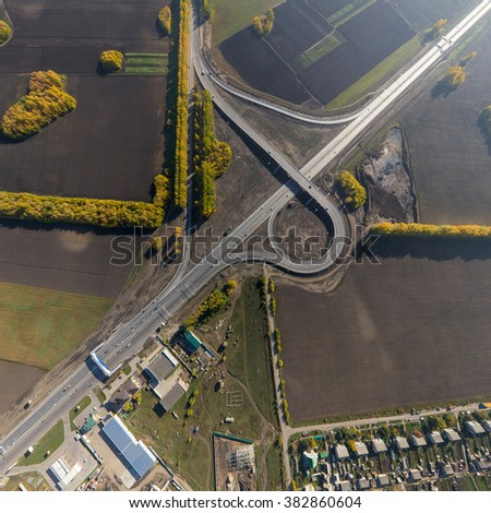 Aerial road interchange, viaduct. Crossroads view parking lots, bridges. Copter shot. Panoramic image.