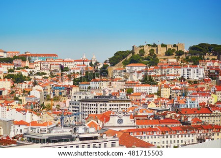 Aerial scenic view of central Lisbon, Portugal with red tile roofs and castelo de Sao Jorge