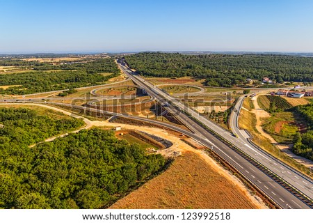 Aerial shot of highway near Pula, Croatia. - stock photo
