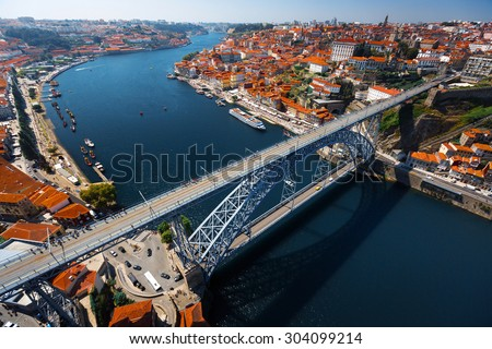 Aerial shot of the metal arch bridge (Dom Luise bridge) between the city of Porto and the city of Vila Nova de Gaia at sunny day. Portugal - stock photo