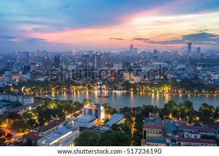 Aerial skyline view of Hoan Kiem lake (Ho Guom, Sword lake) area at twilight. Hoan Kiem is center of Hanoi city. Hanoi cityscape.