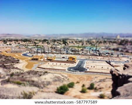 Aerial tilt-shift photo of a southwestern American neighborhood under construction