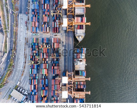 Aerial top down shot of large bangkok shipping port, shipping industry, container, import export logistic,crane,Trade Port,Shipping,Tugboat assisting cargo to harbor.Water transport.International