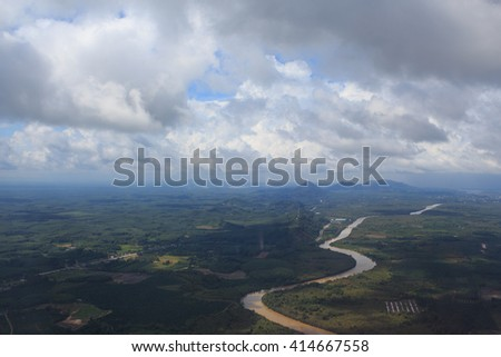 aerial top view from air plane see river and green hills field with clear white cumulus cloud and cloudscape on blue sky - stock photo