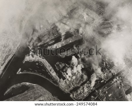 Aerial view after Allied bombing of Howaldtswerke shipbuilding yards in Hamburg, Germany. U.S. B-17 Flying Fortresses bombed the target on August 4, 1943. - stock photo