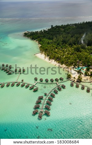 aerial view at Bora Bora island, the lagoon and its islands - stock photo