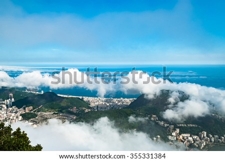 Aerial view at Rio de Janeiro Brazil  on a cloudy day  Panorama view from Christ the Redeemer statue on Corcovado Mountain, city of sport games in 2016 - stock photo