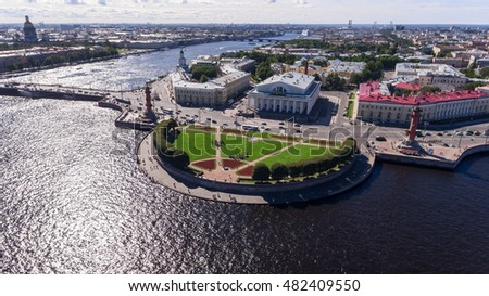 Aerial view at the architecture of spit of Vasilyevsky island and Dvortsovy (Palace) bridge on the Bolshaya (Big) Neva. St. Petersburg, Russia