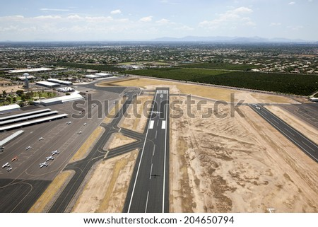 Aerial view atop general aviation airport in east Mesa, Arizona - stock photo