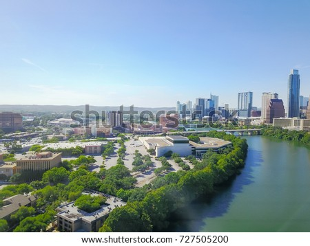 Aerial view Austin state capital of Texas, USA with downtown skyscraper from Lady Bird Lake. Clean and green scene along Colorado River during sunny summer day. Travel and architecture background.