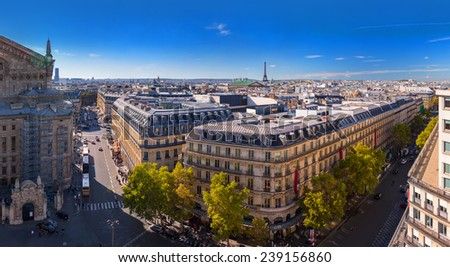 Aerial view big panorama Paris, the Opera Garnier, south-western part, city center, Eiffel Tower - from the rooftop restaurant famous Galeries Lafayette in Paris, France. - stock photo