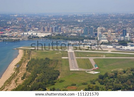 Aerial view  Billy Bishop City Centre Airport  Toronto with the Exhibition Grounds during the Canadian National Exhibition in the background, Toronto Ontario Canada August 24, 2012 - stock photo