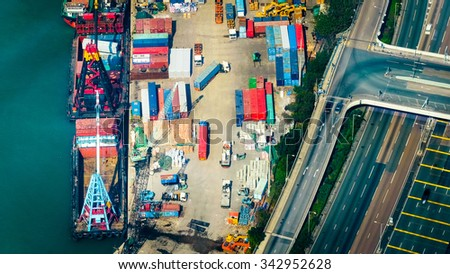 Aerial view cargo ships loaded by crane with cargo containers at a busy port terminal. Hong Kong - stock photo
