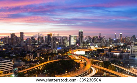 Aerial view city downtown and highway interchanged with beautiful sky during twilight