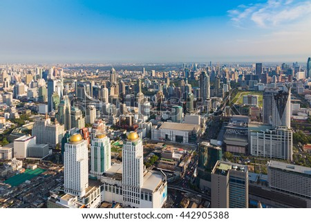 Aerial view city office building downtown with clear blue sky background - stock photo