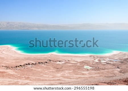 Aerial view Dead Sea coast in desert landscape with therapeutic curative mud and mineral salt  - stock photo