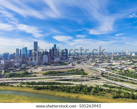 Aerial view Downtown with Interstate 10, 45 and Gulf freeway intersection. Massive highway, stack interchange, viaduct and elevated road junction overpass from Northeast side of Houston, Texas, USA.