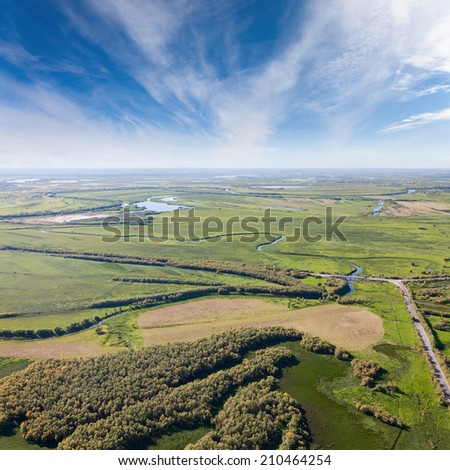 Aerial view forest river and road with bridge on countryside. - stock photo
