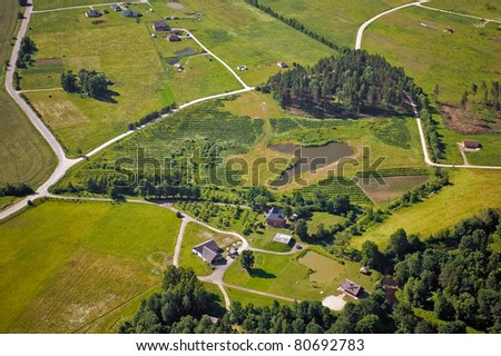 Aerial view from above over rural landscape - stock photo