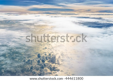 Aerial view from an airplane on a cloudy day.