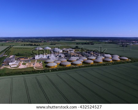 Aerial view from big biogas plant in green fields - germany