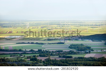 Aerial view from Bratislava towards South with Austrian fields and wind turbines in the background, Slovakia - stock photo
