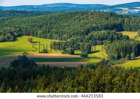 Aerial view from lookout U Jakuba to czech landscape known as Czech Canada. Touristic place. View to forest, field and meadows in sunny day with blue sky