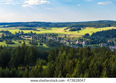 Aerial view from lookout U Jakuba to czech landscape known as Czech Canada. Touristic place. View to forest, field, meadows and small village in sunny day with blue sky
