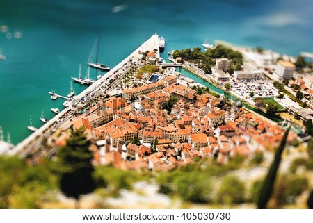 Aerial View from Mountain on Kotor Bay and Old Town, Montenegro. Tilt-Shift Effect, Selective Focus. Red Roofs. - stock photo