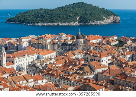 Aerial view from Walls of Dubrovnik with Cathedral and Lokrum island on background, Croatia