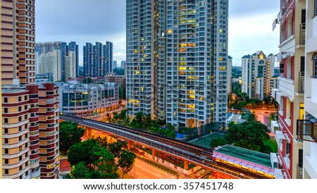 Aerial view group of high rise colorful residential apartments in Redhill neighborhood in Singapore at blue hour. Urban concept. Panoramic style - stock photo