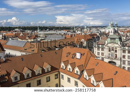 Aerial view: Houses with traditional red roofs in Prague. Prague (Praha) is capital and largest city of Czech Republic and historical capital of Bohemia. Prague situated on the Vltava River. - stock photo