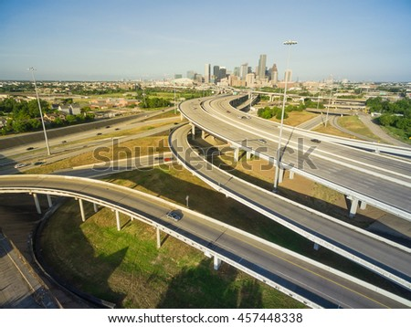 Aerial view Houston downtown and interstate 69 highway with massive intersection, stack interchange and elevated road junction overpass at early morning from the northeast side of Houston, Texas, USA