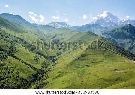 Aerial view in Greater Caucasus Mountains with Mount Kazbek, Georgia - stock photo