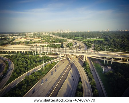 Aerial view interstate 10, Katy freeway and downtown with massive intersection, stack interchange, elevated road junction overpass at late afternoon from the west side of Houston, Texas, US. Vintage.