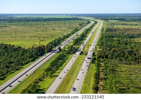 aerial view looking north, of Florida's Turnpike (left) and I-95 (right) in north Palm Beach County, Florida - stock photo