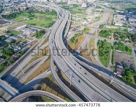 Aerial view massive interstate I69 highway intersection, stack interchange with elevated road junction overpass in downtown Houston. This five-level freeway interchange carry heavy rush hour traffic.