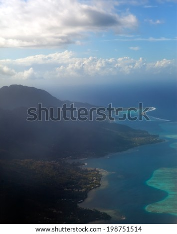Aerial view. Mountain silhouette in the ocean at sunset.  - stock photo