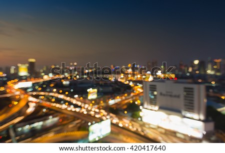 Aerial view night view, blurred bokeh lights, city downtown and highway interchanged - stock photo