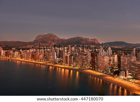 Aerial view of a Benidorm city coastline at sunrise. Benidorm is a modern resort city, one of the most popular travel destinations in Spain. Costa Blanca, Alicante province