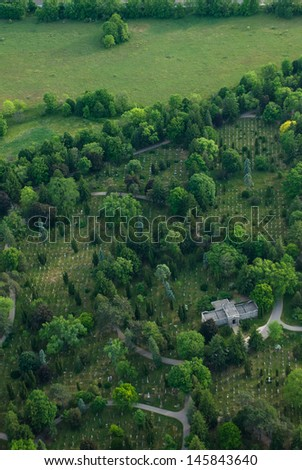 Aerial view of a cemetery with tomb and green trees. - stock photo