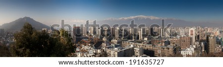 Aerial view of a city and The Andes mountain in the background, Santiago, Chile