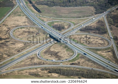 Aerial view of a classic cloverleaf transport intersection at Kievskoe highway in Russia. - stock photo