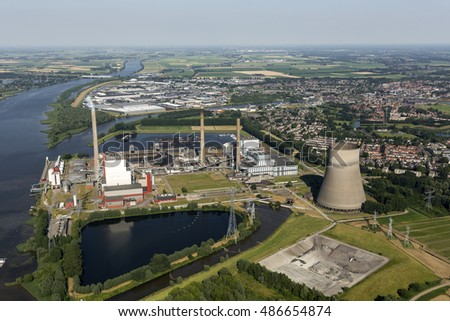 Aerial view of  a coal and biomass fired powerplant. It's located at the river Amer. In the back the town of GEERTRUIDENBERG.