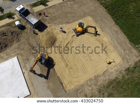 Aerial view of a digger - tracked excavators at work on a construction site - stock photo