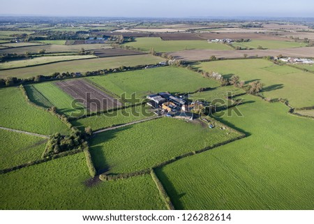Aerial view of a farm set amongst agricultural land in Somerset, UK - stock photo